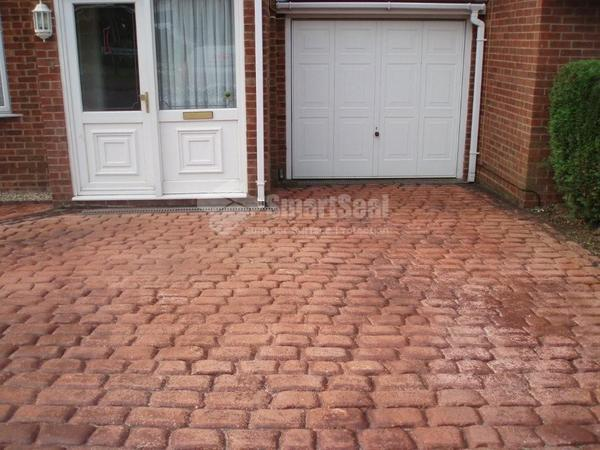 Poor conditioned red driveway