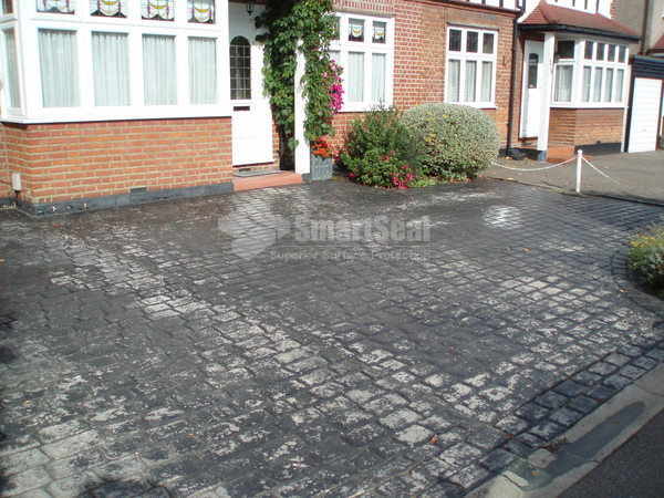Patchy looking imprinted concrete driveway