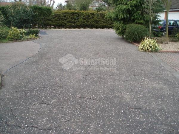 Large tarmac drive before refurbishment