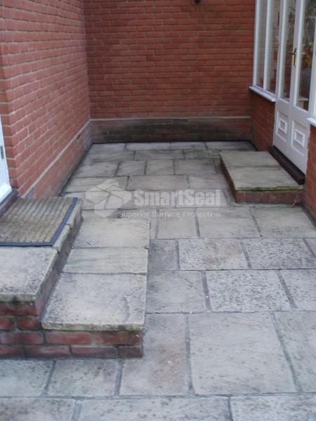 Dirty paving slabs before restoration
