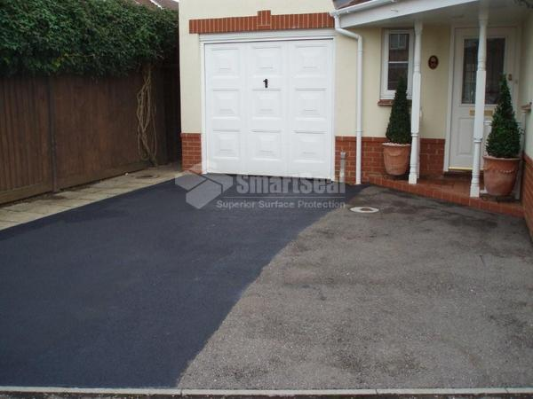 Drive 50% coated with tarmac restorer