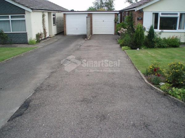 Long tarmac driveway prior to restoration